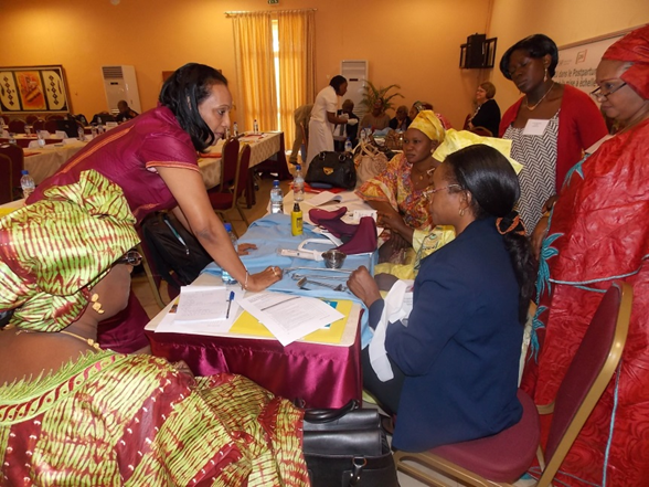 Participants gather for a demonstration of PPIUD insertion using anatomic models at a West Africa regional postpartum family planning workshop in Ouagadougou, Burkina Faso this past February. Photo credit: Jhpiego